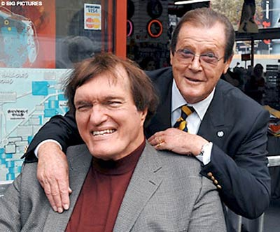 Good friends Richard Kiel and Roger Moore celebrate Moore's Star on the Walk of Fame in 2007.