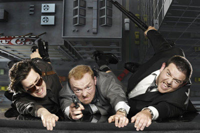 Wright, Pegg & Frost hanging from a rooftop